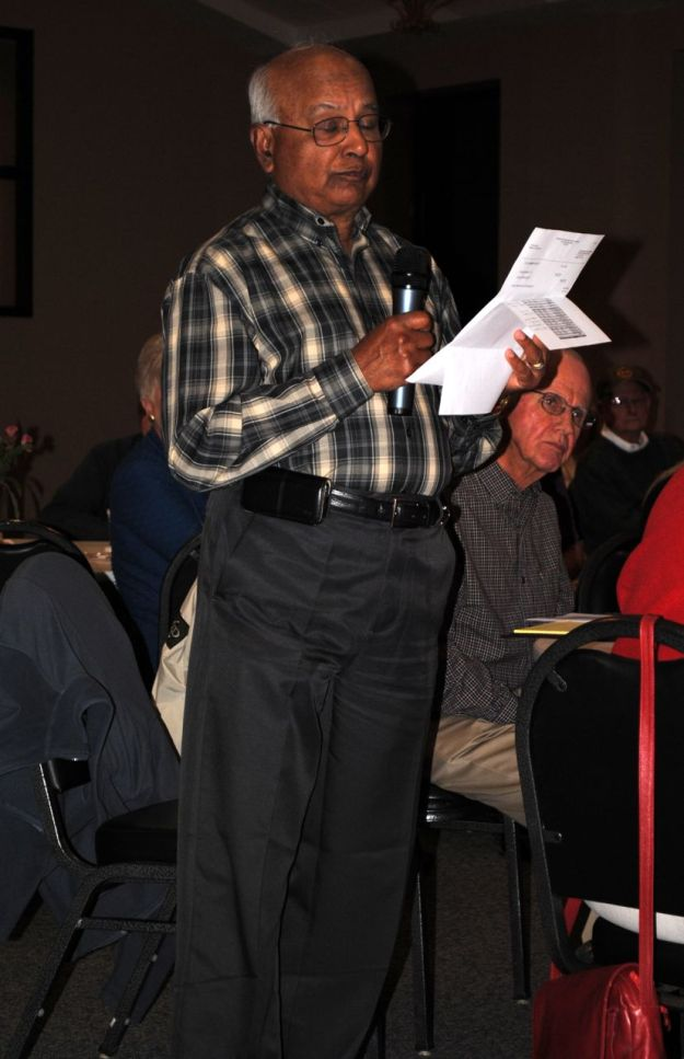 A resident receives clarification on the financial reports.