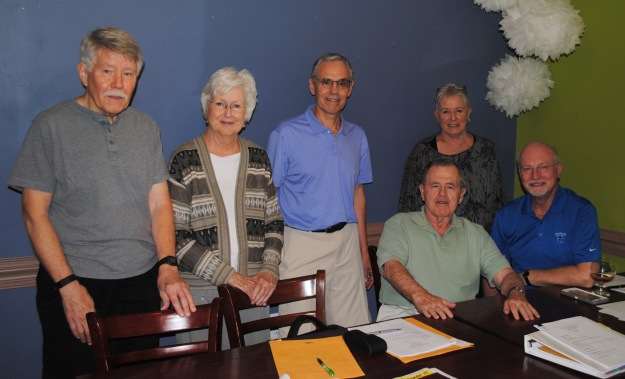 Architectural Review Board (ARB) left to right - standing are Ted Smith, Rosemary McGee, Dan Kuntzman and Debbi Nichols, ARB Chair. Sitting are Jack Sahadi and Frank Ferreira. Absent are Ken Brady, Ron Risch and Wes Weaver, POA Board ARB liaison. Photo: Bean & Barrel.